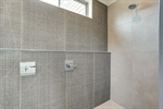 Stunning tile work in walk-in shower