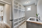 MudLaundry room with built-ins