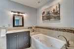 Relax in the jetted soaking tub with tile surround