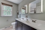 Hall bathroom with double vanity
