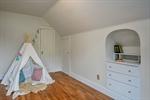 Adorable second floor bedroom with built ins
