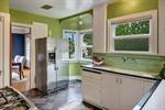 The kitchen boosts a bay window