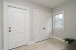 Mudroom with double closet and door to Garage