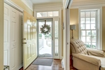 Bright foyer with shutters for privacy