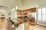 Wood cabinets and granite counters gleam!