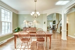 Formal dining room with arches and chair rail