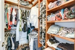 Owners closet features custom shelving