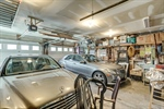 Large 2 car garage with storage opens to basement