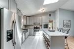 Stainless appliances and tile backsplash shine!