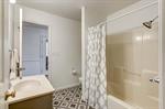 Full bathroom with doors to bedroom 2 and hallway