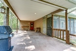 Carport leads to mudroom and screened porch