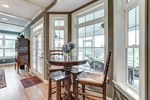 Bay windows look onto screened porch