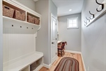 Mudroom features storage cubbies and built-in desk