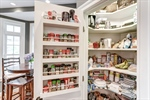 Pantry features custom spice rack
