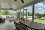 Screened porch with room for meals and relaxing!
