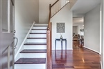 Warm hardwoods throughout main living spaces