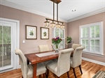 Dining area with Asheville artistian light fixture