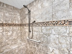 Beautifully appointed walk-in tiled shower