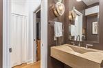 Pocket door creating half bath for guests