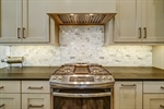Marble tile backsplash is stunning