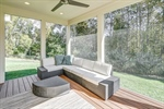 Enjoy the outdoors on the screened porch