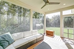 Screened porch is private and serene