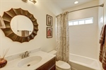 Full bathroom with subway tile in shower