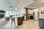 Gourmet kitchen opens to vaulted great room!