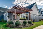 Relax outdoors on the patio with cedar pergola