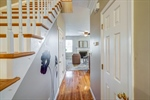 Hallway leads to kitchen and great room