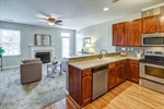 Kitchen features cherry cabinets