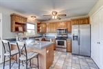 Kitchen features oak cabinets with storage!
