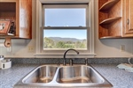 Enjoy the views and the double sink.