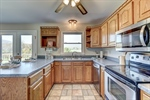 Stainless appliances include new microwave.