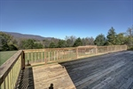 Large deck offers mountain views.