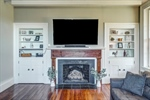 Gas fireplace surrounded by original built-ins