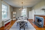 Formal dining room with wood fireplace