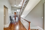 Basement stairs lead down to laundry and apartment
