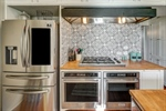 Stunning tile backsplash and new refrigerator
