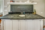 Prep sink with soapstone countertop.