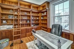 Work from home in the wood paneled library