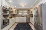 Stainless appliances granite countertops and tile
