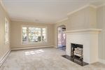 Living Room w large front windows and WB FP