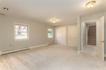 Large owners suite on main level w four closets