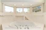 Jetted tub with surround for personal items