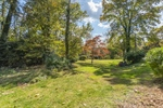 Yard is .82 acres with areas for gardens