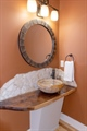Jasper stone vessel sink and natural edge counter