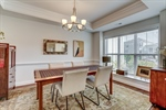 Dining room with tray ceiling and chair rail.