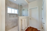 Walk in shower and direct access to laundry room