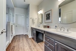 Double vanity with separate water and linen closet